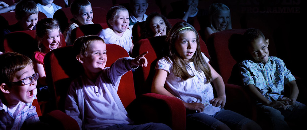 school children watching film