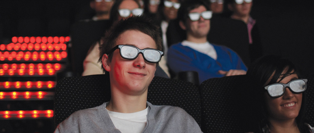 cinema goers with 3D glasses